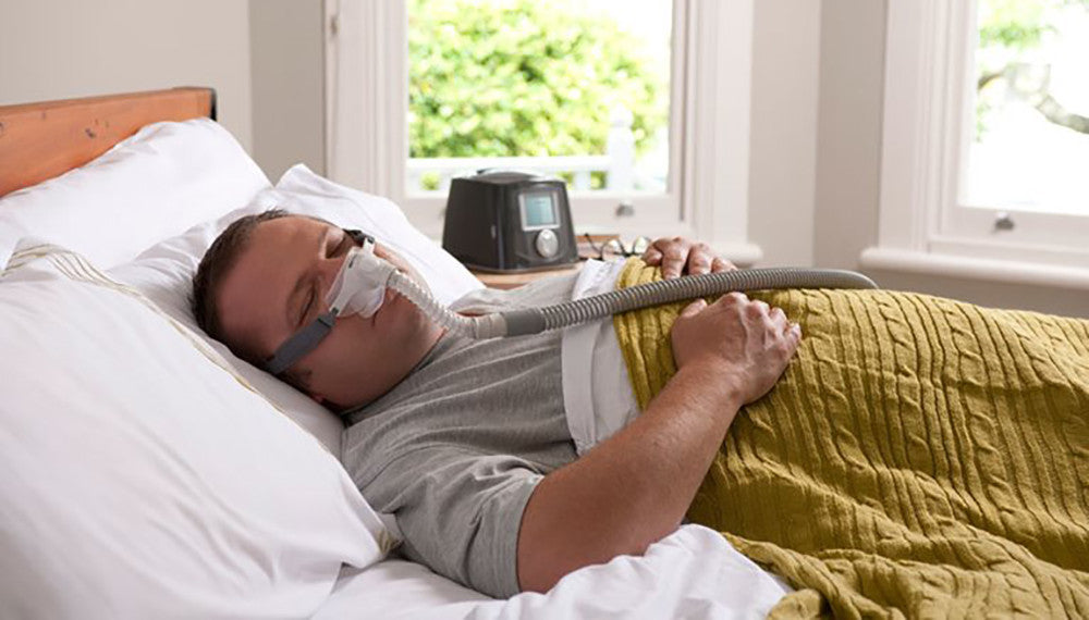 Man sleeping with a CPAP mask on