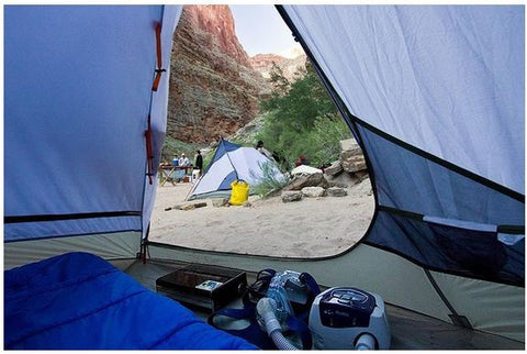 Camping in a tent image