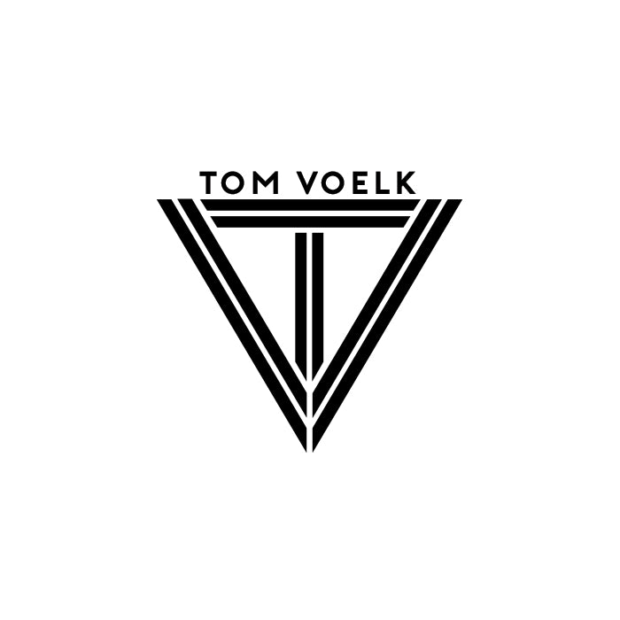 Gibran Hamdan designed Tom Voelk logo, website, and apparel