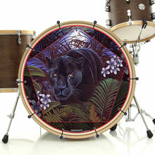 Panther in nature graphic bass face banner art installed on bass drum; visionary drum art