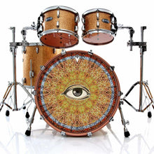 Drum set with Seeing pattern and eye graphic drum skin on bass head