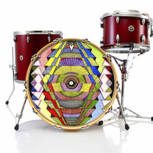 Singular Vision graphic drum skin installed on bass drum head and shown on red drum kit; visionary drum art