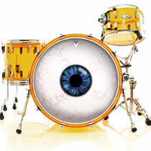 Eyeball graphic drum skin installed on bass head on a gold drum kit; third eye drum art