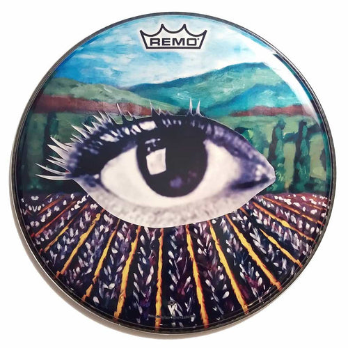 Eye in a lavender field graphic drum head. Head by Remo.
