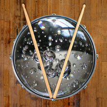 Glass bubbles drum skin on snare drum