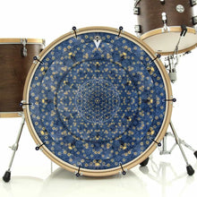 Gold Flower Portal bass face drum banner installed on drum kit; blue drum art