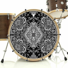 Growing Sun bass face graphic drum banner installed on drum kit; visionary drum art