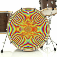 Here We Grow Again bass face drum banner installed on drum kit; rainbow circle drum art