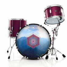 Hex Nouveau graphic drum skin installed on bass drum head shown on red drum kit; red hexagon drum art