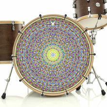 Kaleidoscopic bass face drum banner installed on bass drum head; visionary drum art