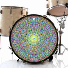 Kaleidoscopic graphic drum skin installed on bass drum shown on drum kit; yellow abstract drum art