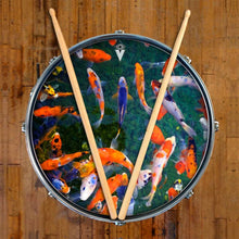 Koi graphic drum skin on snare drum head by Visionary Drum; orange drum art