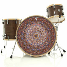 Kaleidoscopic mandala graphic drum skin art on drum kit