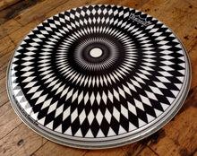 "Radial diamond pattern black and white design 14"" Graphic Remo drum head, angle shot."