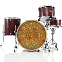 Rust Mandala graphic drum skin installed on bass drum head and shown on drum kit; orange pattern drum art