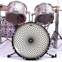"Drum set with glossy 20"" Spherical Motion graphic drum head on bass"