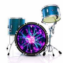 Tesla Coil graphic drum skin installed on bass drum head and shown on blue drum kit; electric drum art