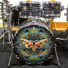 Drum set with The Moth graphic drum skin on bass head