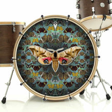 The Moth bass face drum banner installed on bass drum; gold nature drum art