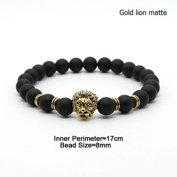 Bracelet made of black stone with a lion's head (gold lion matte ).