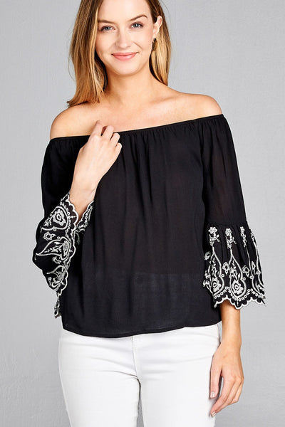Ladies fashion 3/4 sleeve w/floral embo scallop hem off the shulder woven top - Black with White accents