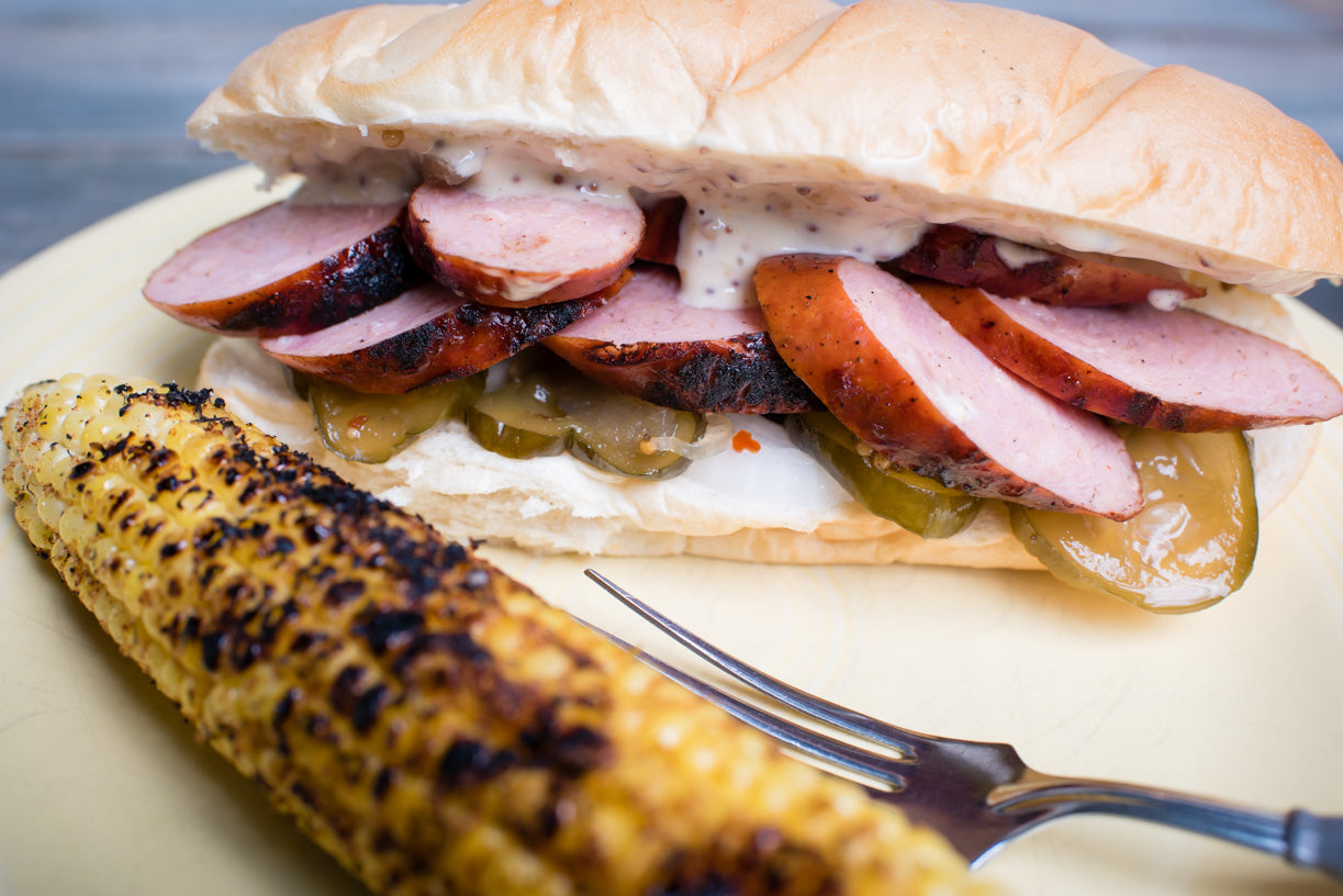 Andouille Po Boy Sandwiches with Cajun Grilled Corn and Grillo's Pickles