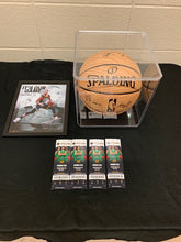 "#7 Live Auction for Girls Basketball: ""Man Cave""- Miami Heat Autograph Basketball, Steph Curry Autograph,  4 Notre Dame men's basketball tickets, Recliner - Tiger Apparel"