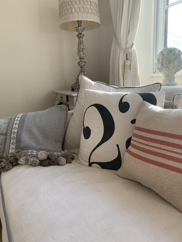 https://theinteriorco.co.uk/collections/soft-furnishings/products/grey-throw-rabbit-pompom
