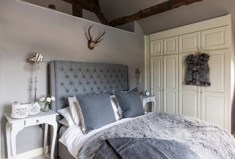 Master bedroom design in a period oak framed farmhouse by The Interior Co