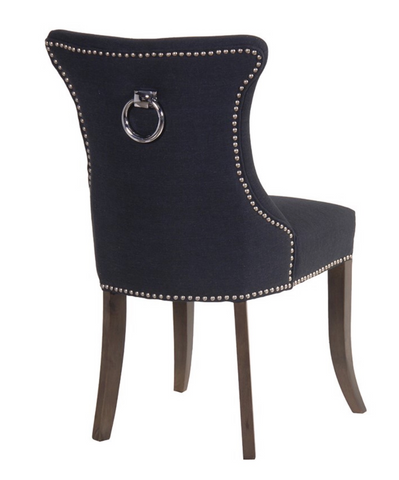 Black Studded Dining Chair with Ring  Simple, clean lines with an encompassing curved back, with a silver ring back detail, the Black studded dining chair has the timeless appeal of a true classic.  Dimensions: H: 970mm W: 590mm D: 630mm