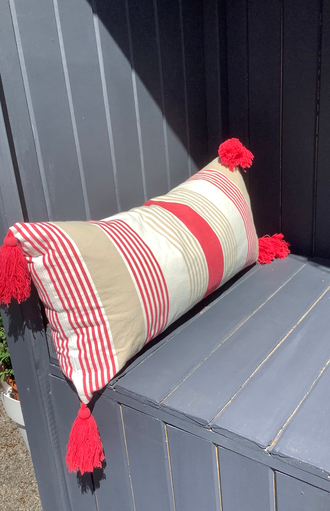 Red Striped Long Cushion with Red Tassels Lindum