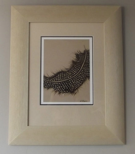 A Gineau Fowl feather Print in a Cream Frame