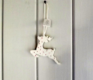 Leaping reindeer wooden cream spotty