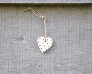 small cream wooden heart on string