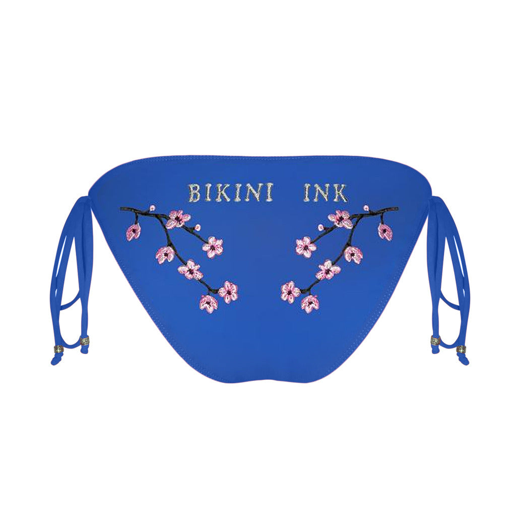 Bikini Ink embroidered cherry blossom tattoo bikini in demand inked bikini  bottom in bright blue tie side cut. Stylish Bikini Ink bikini bottom with cherry blossoms and tattoo inspired  bikini  artwork