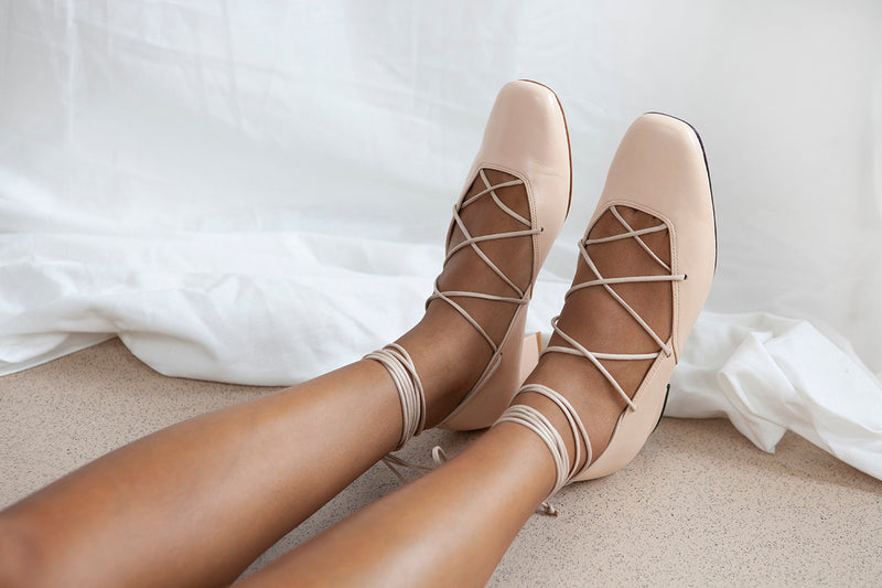 Elinor lace up detail ballet pump in soft nude pink kid leather by Miss L Fire. Inspired by a 1040's Vogue photo shoot. Made in Portugal.