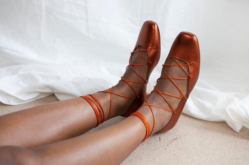 Elinor vintage style ballerina pump with criss-cross laces in rust metallic leather with leather lining and outsole. Made in Portugal by Miss L Fire.