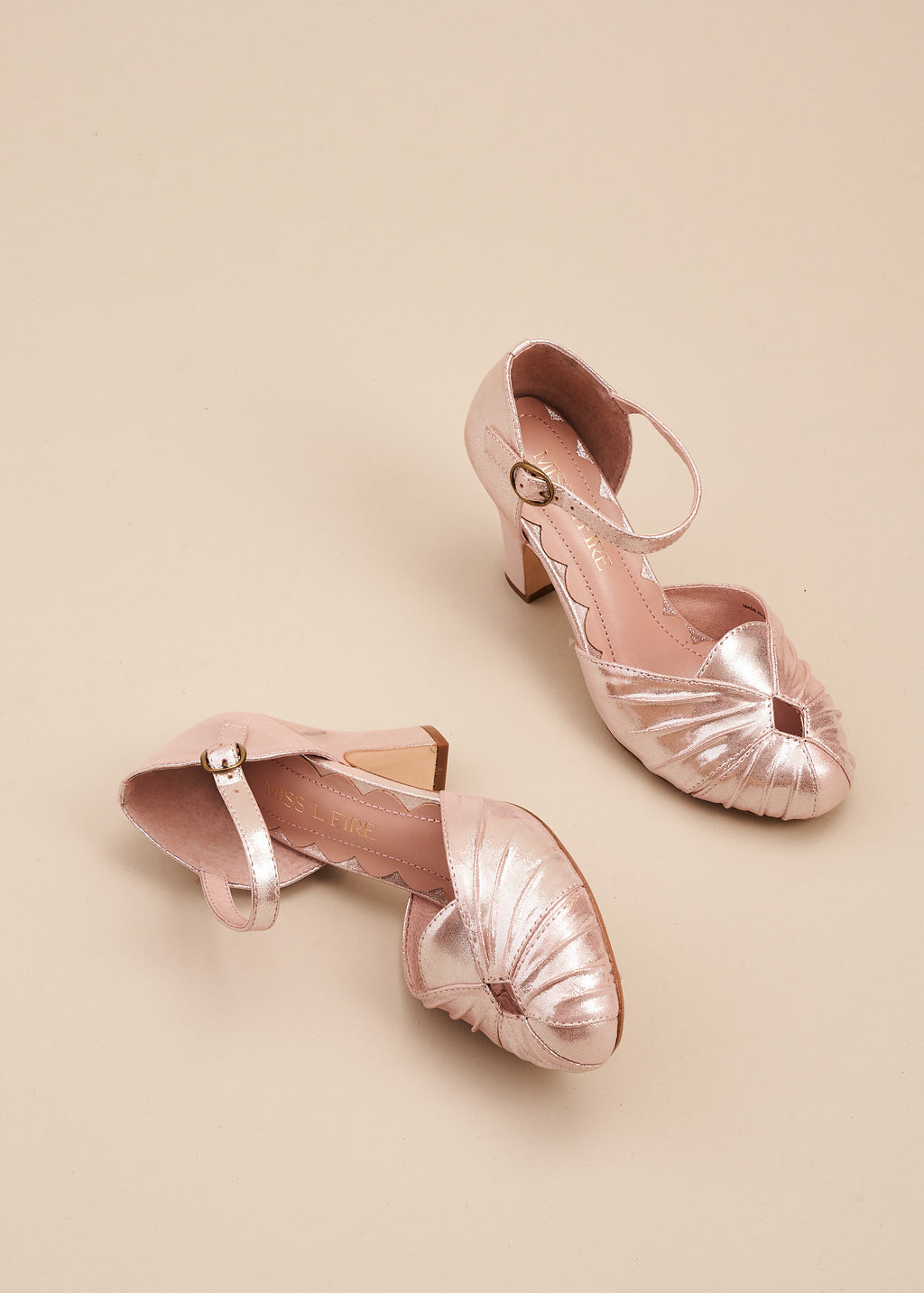 Amber in gorgeous copper pink sparkle suede by Miss L Fire, is a vintage inspired 2 part bar shoe with ruched detail on the toe and adjustable strap.
