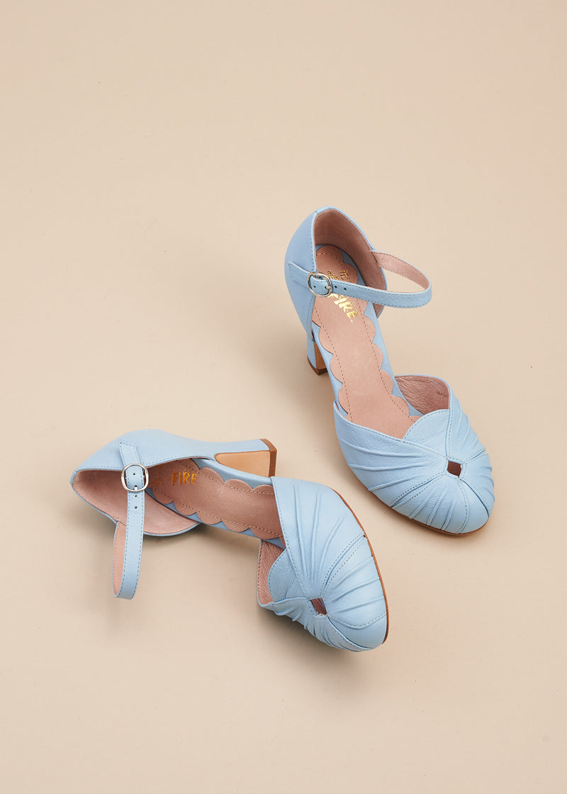 Amber in soft baby blue leather is a vintage inspired two part bar shoe with ruched detail on the toe, an adjustable strap, and a 6cm heel. By designer Miss L Fire.