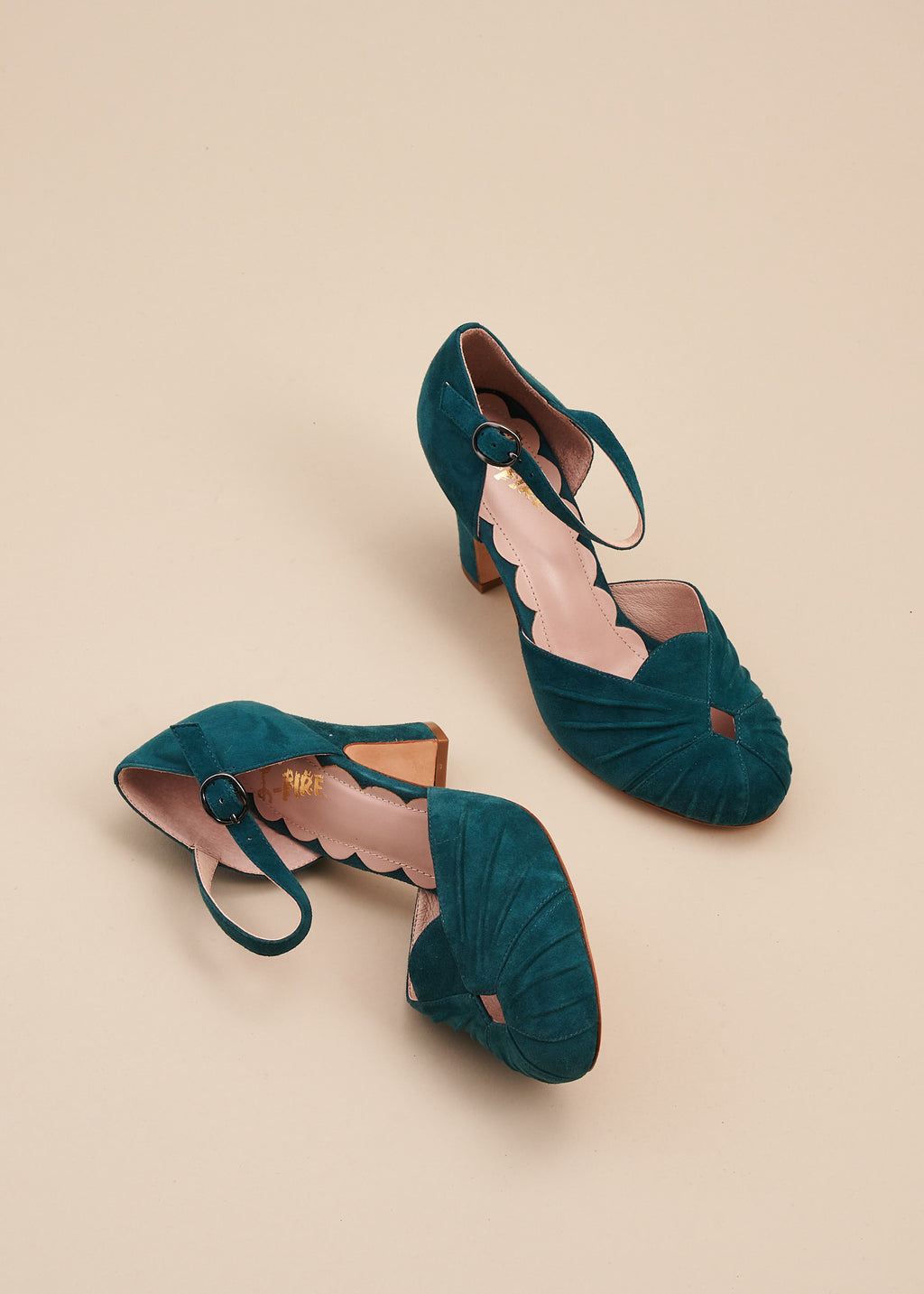 Amber in soft teal suede is a two part, vintage inspired bar shoe by designer Miss L Fire. Amber features an 8cm heel, ruched detail on the toe and an adjustable strap.