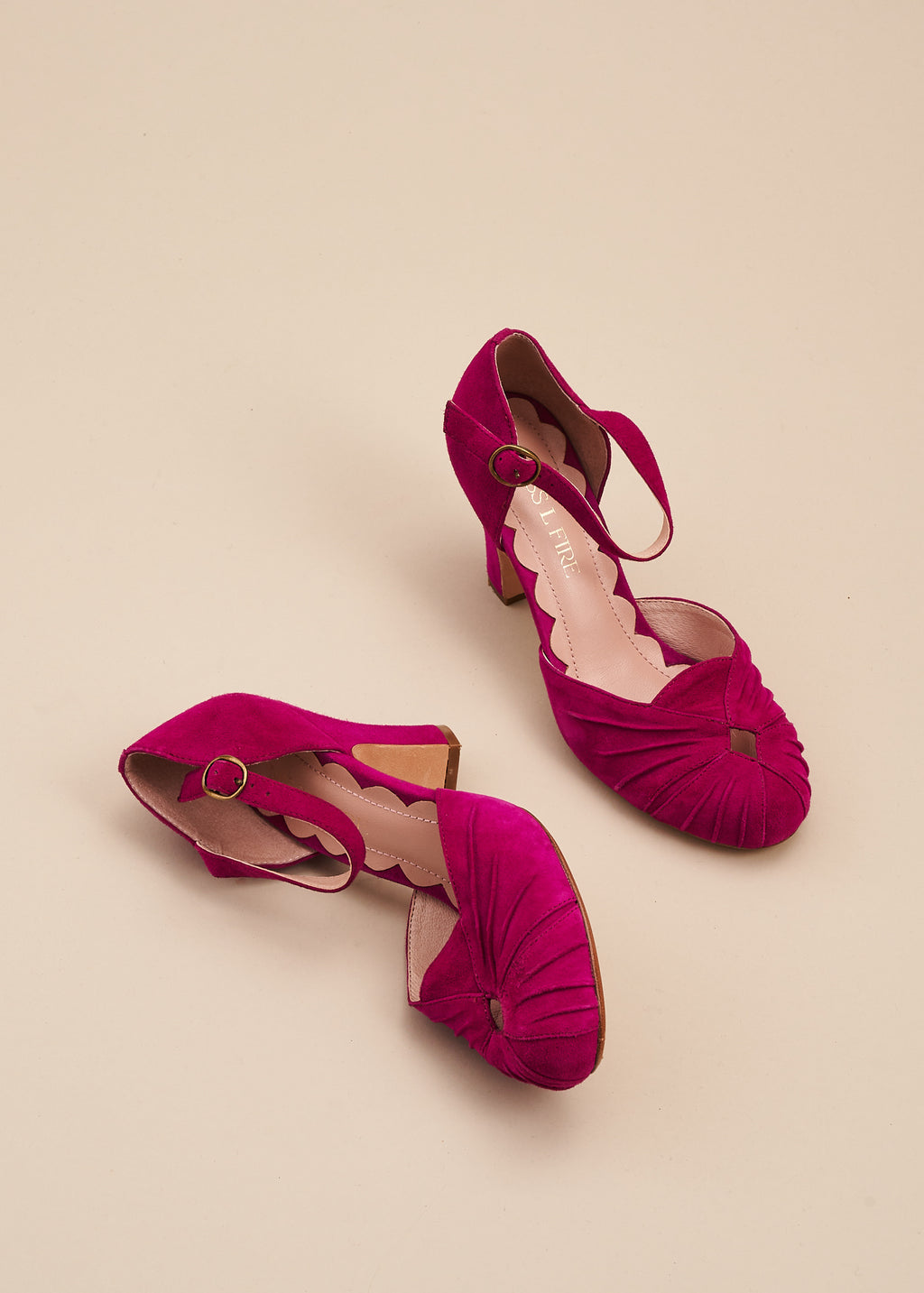 Amber in jewel-like violet suede is a two part, vintage inspired bar shoe by designer Miss L Fire. Amber features an 8cm heel, ruched detail on the toe and an adjustable strap.