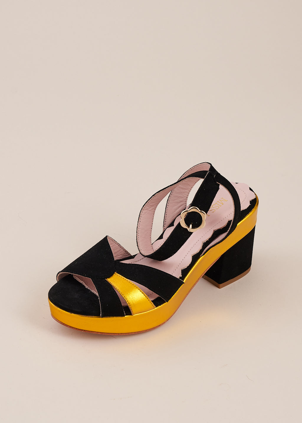 Cora in black suede and gold leather by Miss L Fire is a half wedge sandal with vintage art deco inspired sunburst detail. Small batch, ethically hand made in Spain.