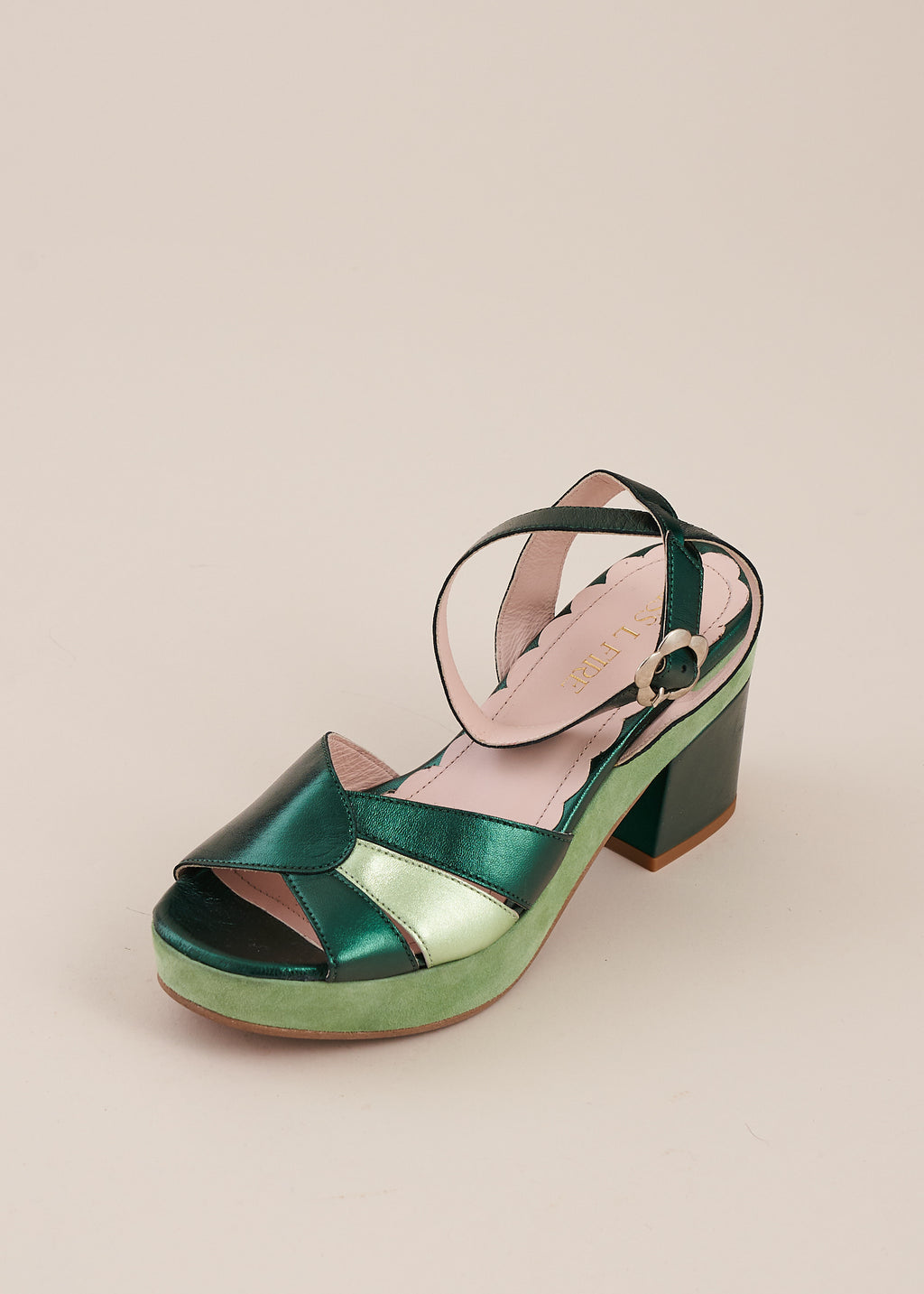 Cora in mint green suede and emerald green metallic leather by Miss L Fire is a half wedge sandal with vintage art deco inspired sunburst detail. Small batch, ethically hand made in Spain.