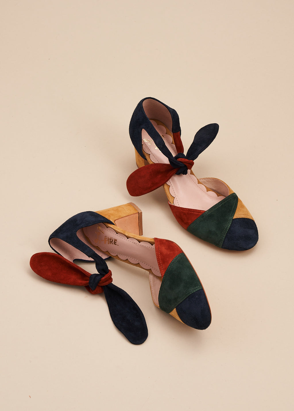 Clarice in multi jewel tone suede is an Art Deco inspired two part shoe with soft suede ankle tie detail and 6cm heel. Perfect for all occasions, or dressing up at home! By designer Miss L Fire.