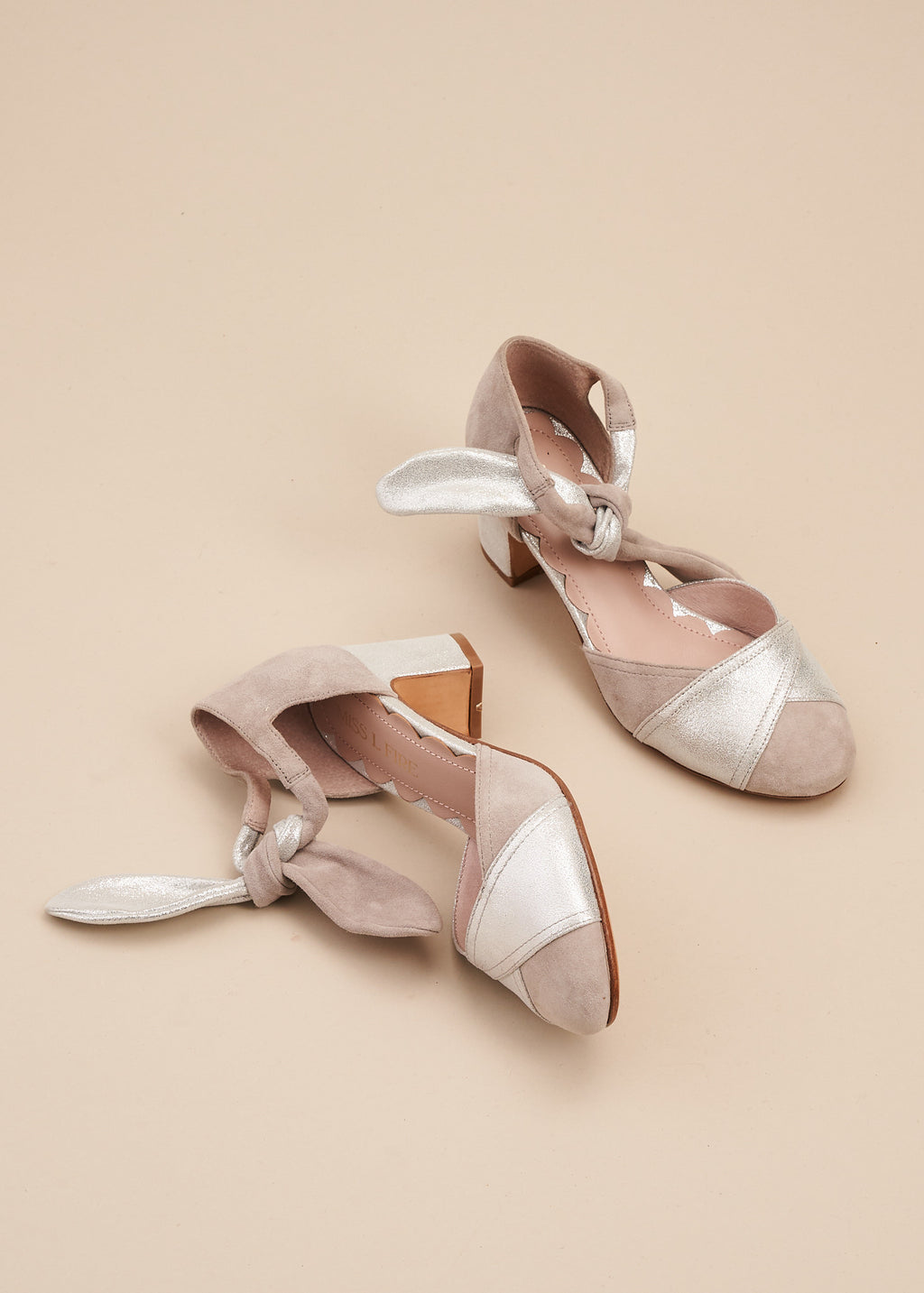 Clarice in soft silver and grey suede is an Art Deco inspired two part shoe with soft suede ankle tie detail and 6cm block heel. Perfect for all occasions, or dressing up at home! By designer Miss L Fire.