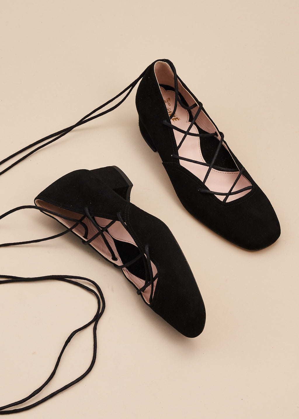 Elinor in soft black kid suede is our beautiful criss cross lace up ballet pump on a 3cm block heel. This gorgeous shoe is perfect for remaining glamorous whilst working from home, or when heading out for walks. Perfect, every day luxury from Miss L Fire. Made in Portugal.