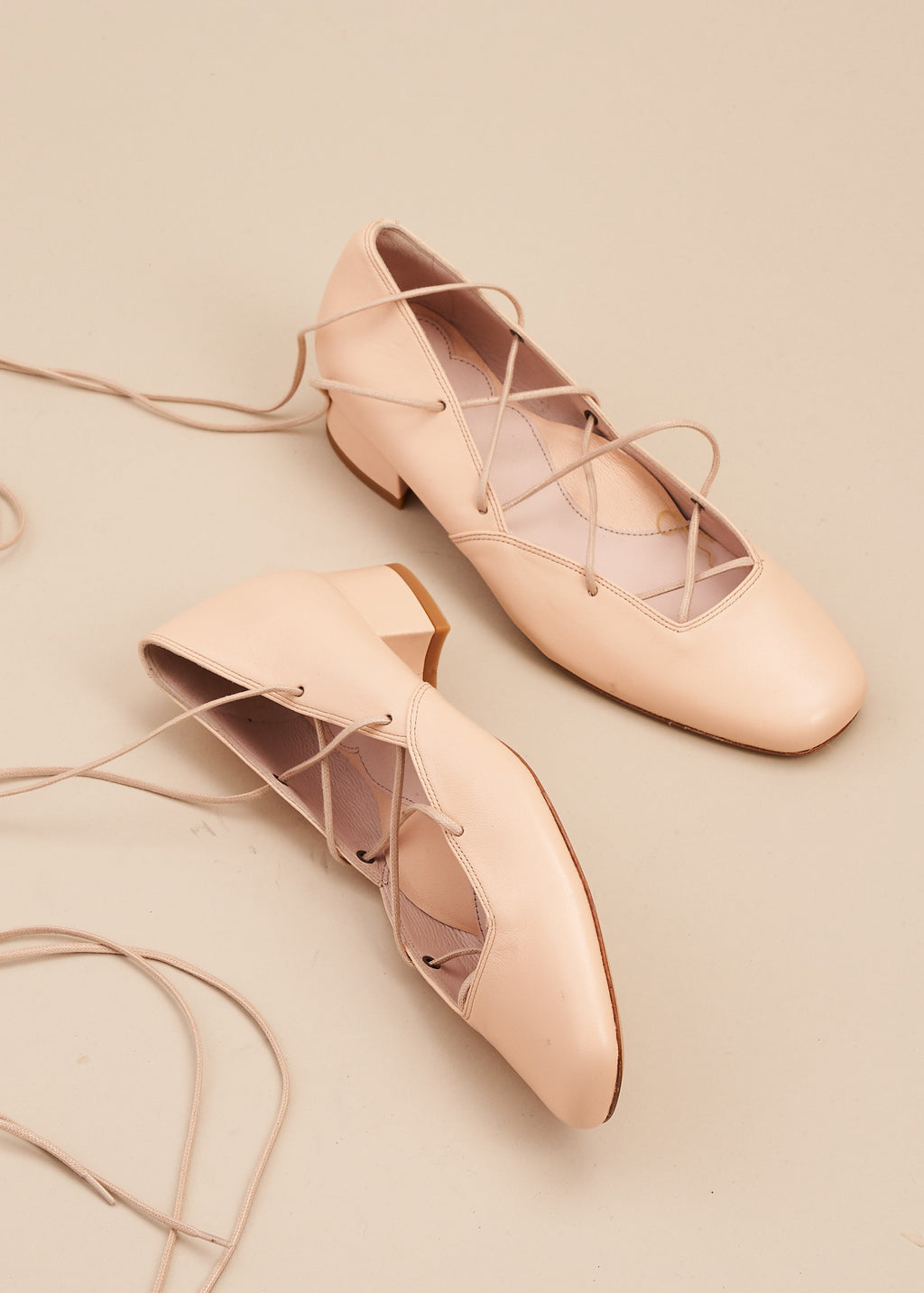 Elinor in soft nude pink leather is our beautiful criss cross lace up ballet pump on a 3cm block heel. This gorgeous shoe is perfect for remaining glamorous whilst working from home, or when heading out for walks. Perfect, every day luxury from Miss L Fire. Made in Portugal.