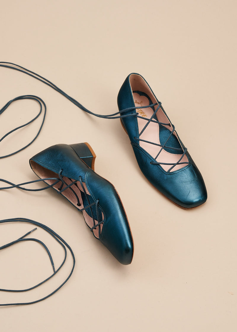 Elinor in jewel tone teal metallic leather  is our beautiful criss cross lace up ballet pump on a 3cm block heel. This gorgeous shoe is perfect for remaining glamorous whilst working from home, or when heading out for walks. Perfect, every day luxury from Miss L Fire. Made in Portugal.