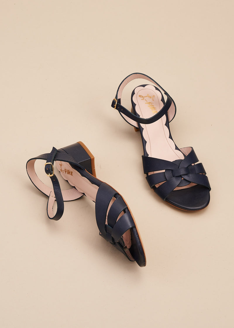 Isla in buttery classic navy leather is a beautiful elegant sandal with interwoven vamp and 4cm block heel. This is the perfect every day , work from home sandal, by designer Miss L Fire.