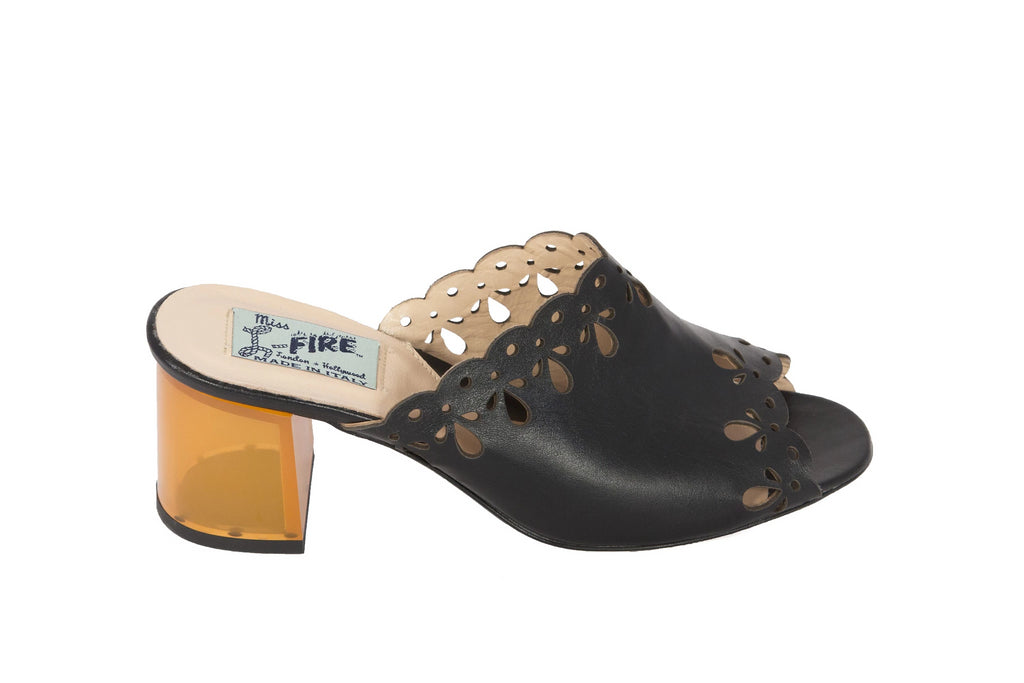 Joanna Black mules with transparent amber heel.